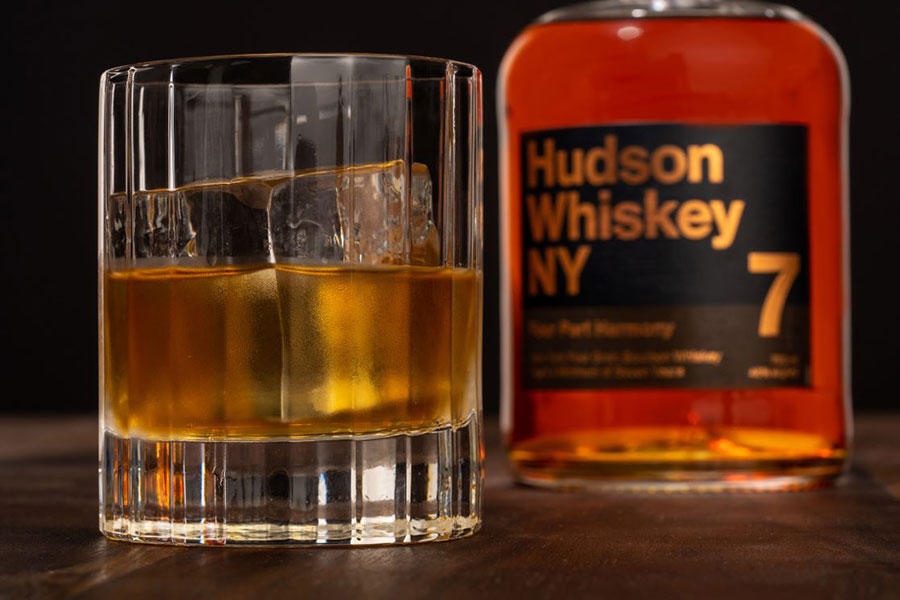 Hudson Whiskey Four Part Harmony Bourbon poured in glass