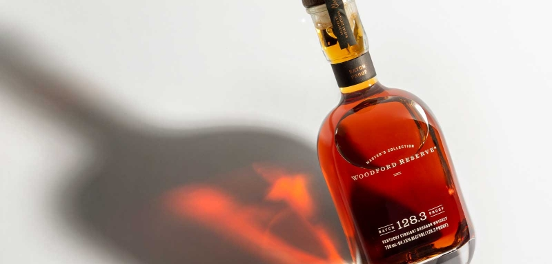 Woodford Reserve Batch Proof 128.3 Master's Collection bottle and shadow
